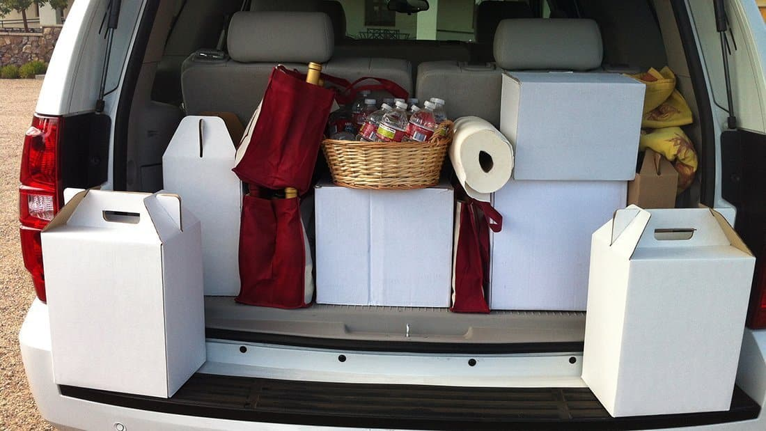 The back of one of our wine tour vehicles filled with cases of wines.
