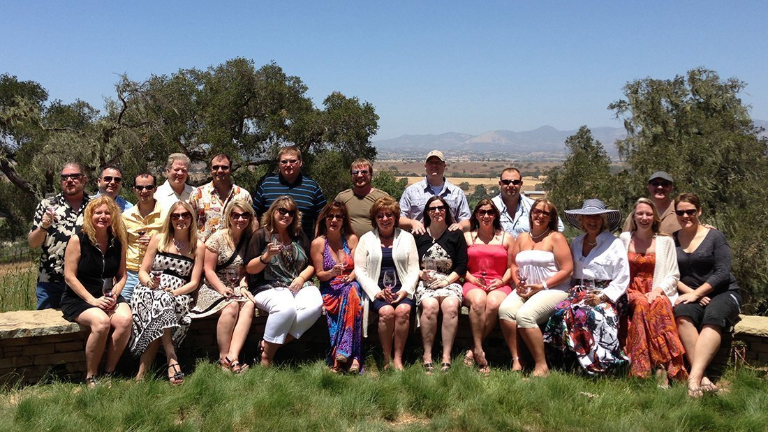 a group of family and friends on a large group wine tour