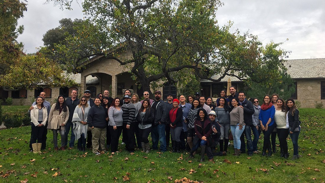 A large group of happy wine lovers touring santa barbara wine country.
