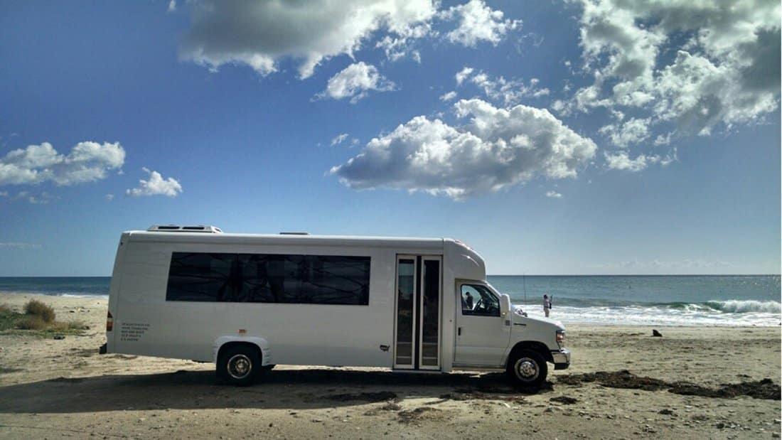 Our 24 passenger mini coach at the beach, a stop requested by a wine tasting group.