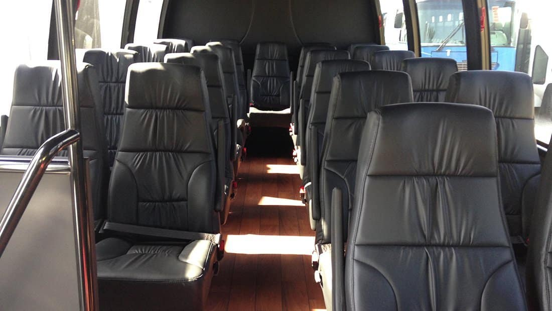 View of the seating and laminate flooring in our 24 passenger mini-coach