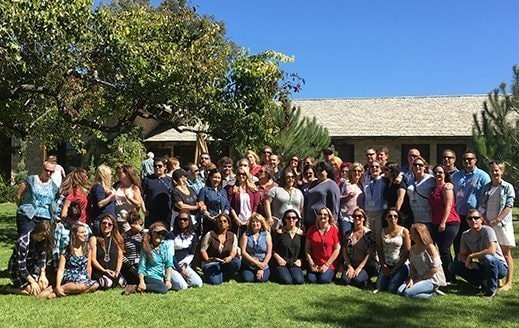 This large group Santa Barbara Wine Tour is enjoying their day and posing for a group picture at a private estate vineyard.