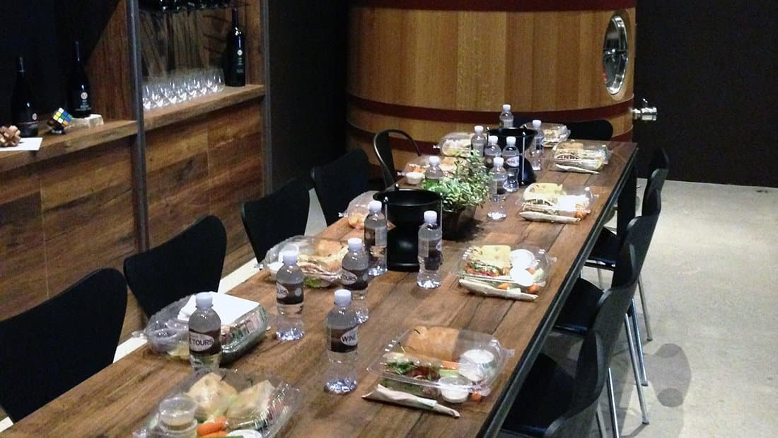 It's raining outside so the lunch is set up in the barrel room.