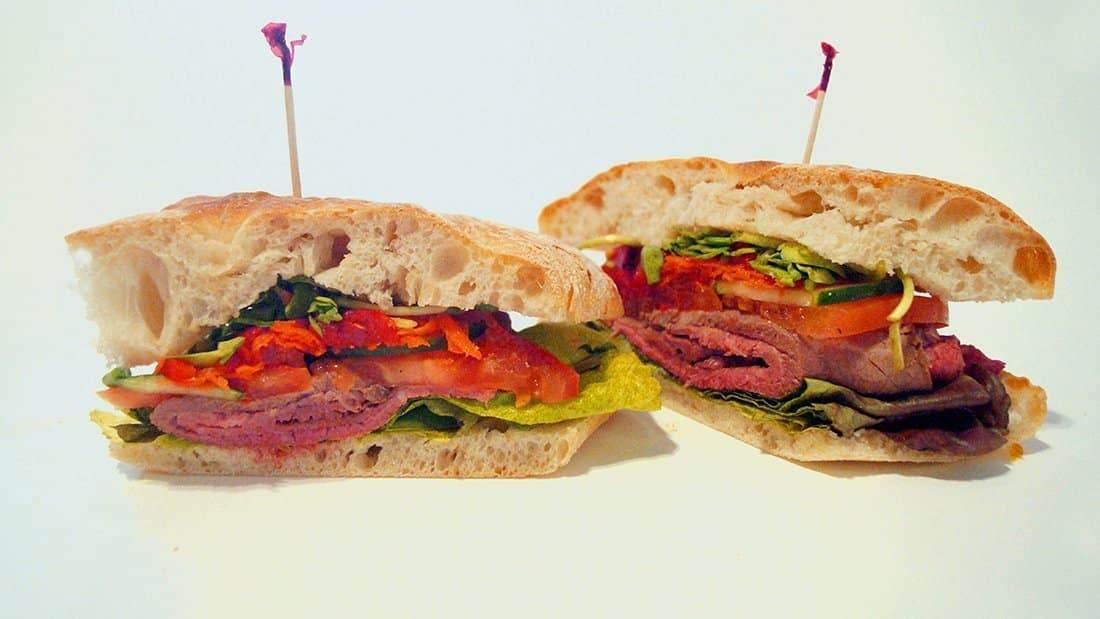 All Natural Roast Beef Sandwich: fresh foccacia with lettuce, tomato, sprouts, carrots, cucumbers, fire-roasted red peppers and served with a side of horseradish.