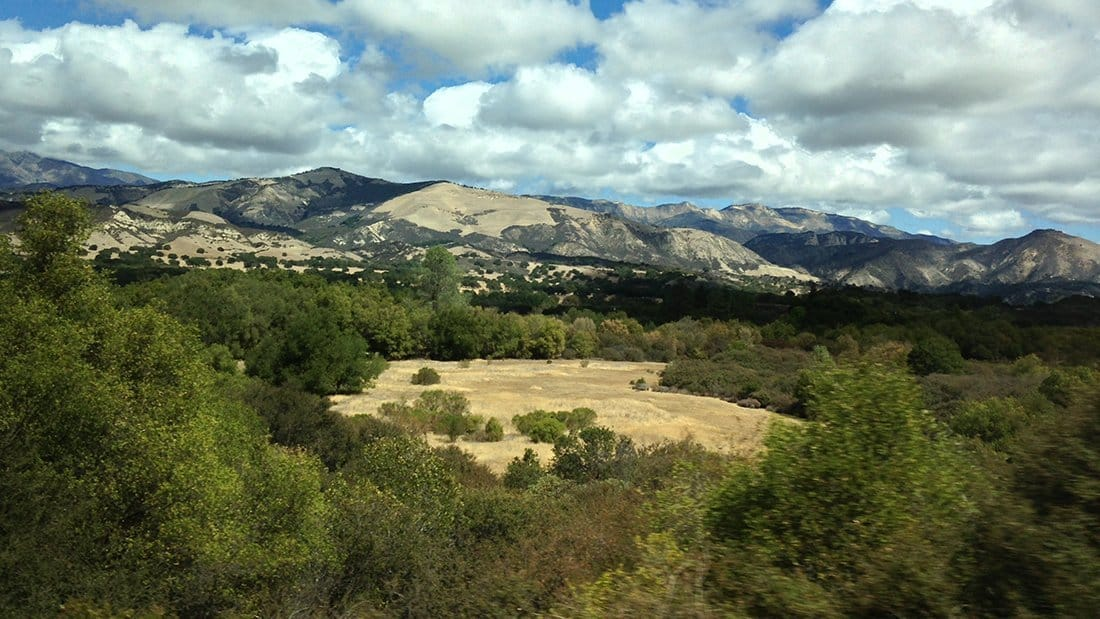 The Santa Ynez Valley with dramatic skies and views of the golden mountains