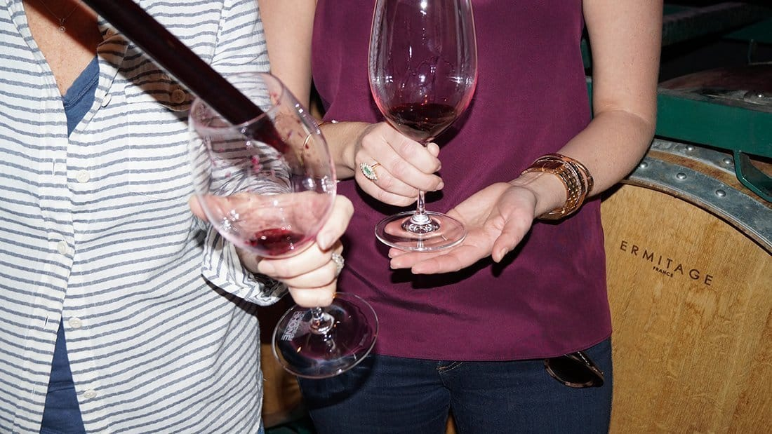 """Using a """"wine Thief"""" a winemaker let's our guests sample wine in a barrel."""
