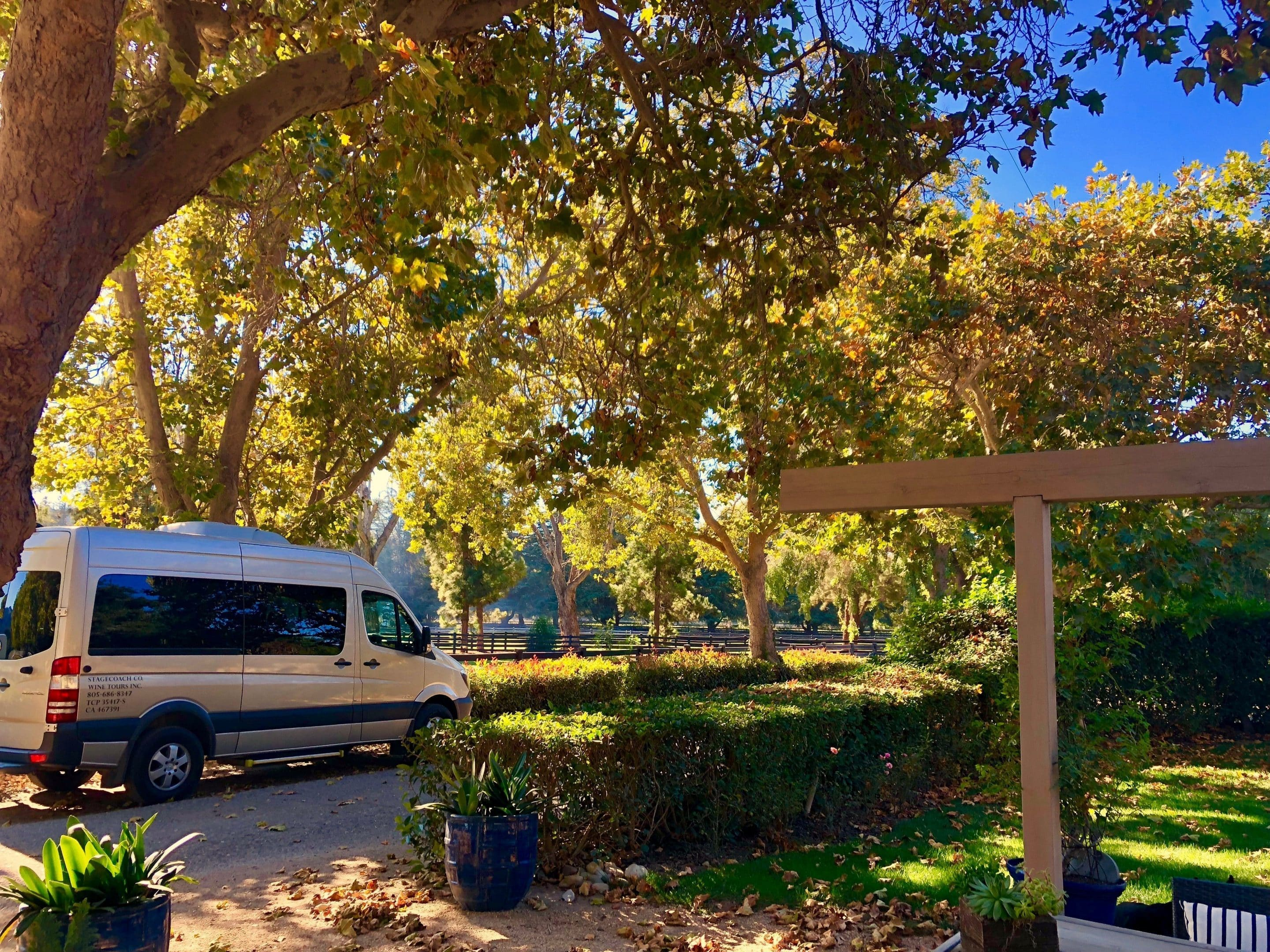 Our wine tour van parked at a beautiful venue.