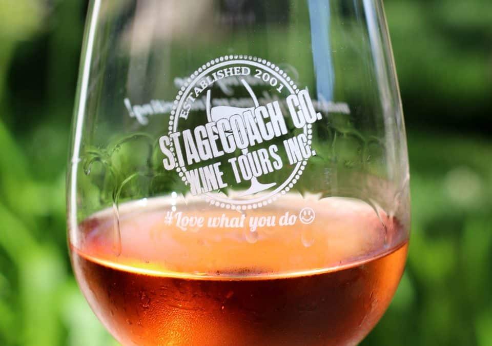 A Stagecoach Co. logo glass of wine